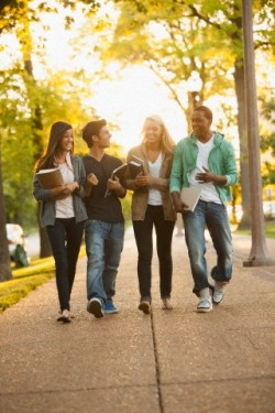 Students walking together on campus --- Image by © John Fedele/Blend Images/Corbis