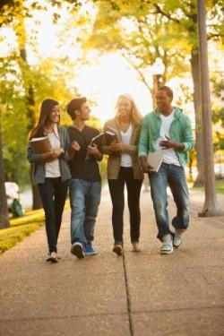 Students walking together on campus --- Image by © John Fedele/Blend Images/Corbis